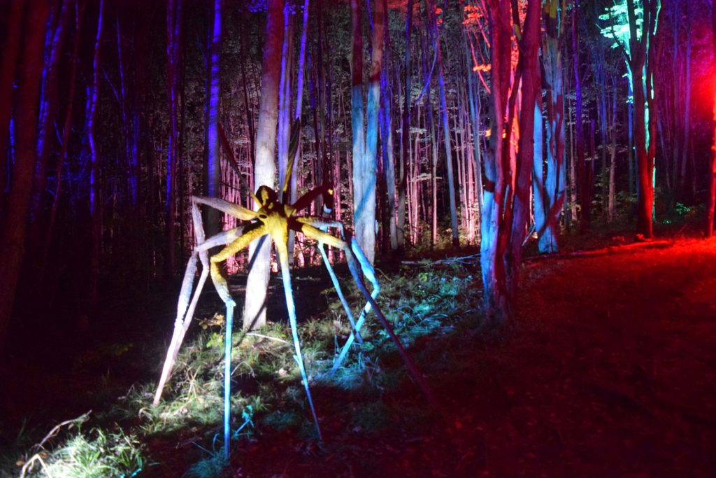 sculpture of giant mosquito illuminated in LED lights at sculpture park