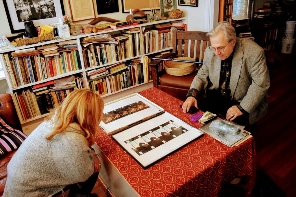 Warhol Superstar shows woman his iconic images